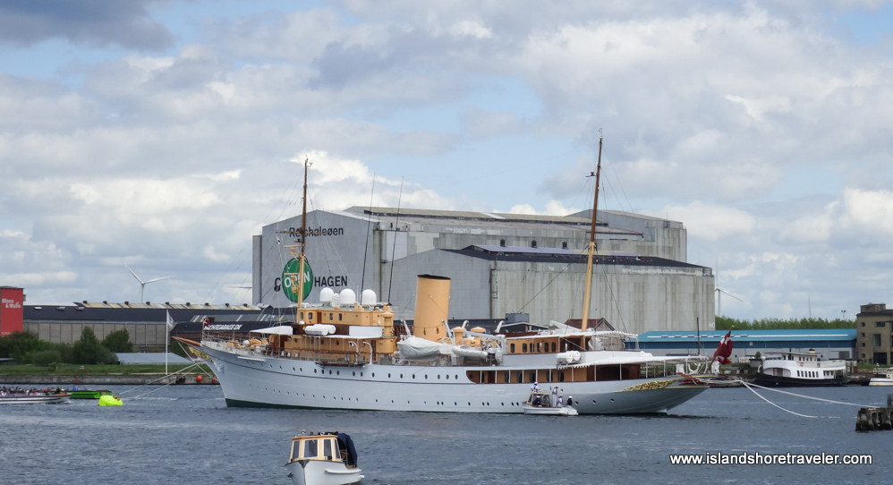 White yacht with gold trim berthed in Copenhagen